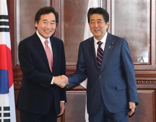 韓国の李洛淵首相と安倍晋三.PNG